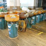 Overall View of Large Quantity 1.2 Cubic Ft Sweco Vibratory Tumblers